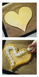 Making heart-shaped cake with cream border