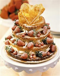 Tiered cake with white chocolate cream and strawberries