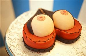 Erotic gateau in shape of heart with bosom decoration