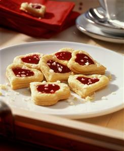 Puff pastry hearts filled with raspberry jam