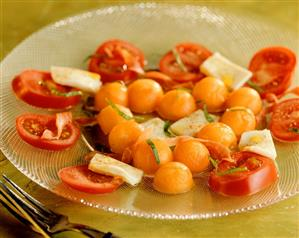 Tomato and mozzarella salad with melon balls