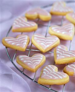 Decorated sweet pastry hearts on a rack
