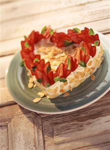 Heart-shaped strawberry and cream gateau