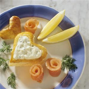 Puff pastry heart with herb quark filling, salmon roll & dill