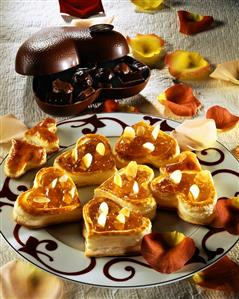Puff pastry hearts with jam and almonds; Pralines
