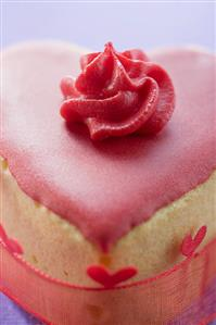 Small heart-shaped cake with pink icing