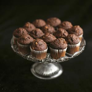 Mini chocolate muffins on a pedestal cake stand