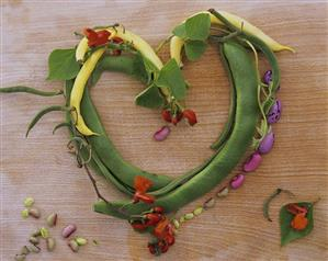 Yellow and green beans with flowers, forming a heart