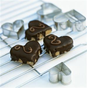 Heart-shaped biscuits with chocolate icing