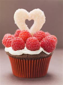 Chocolate cupcake with raspberries for Valentine's Day