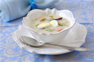 Sour flour soup with boiled eggs and sausage
