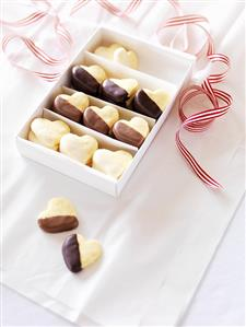Chocolate-dipped shortbread hearts in a box