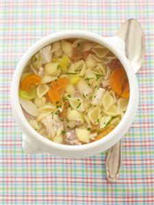 Chicken soup with pasta and carrots (overhead view)