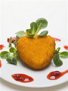 Deep-fried Camembert heart with corn salad & cranberry sauce