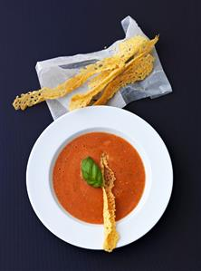 Cold tomato and pepper soup with cheese crisps