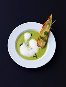 Minted cream of pea soup with toast