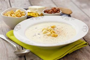 Creamy cheese soup with croutons