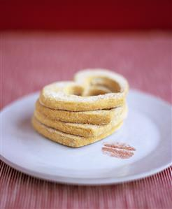 Heart-shaped biscuits and lipstick mark on plate